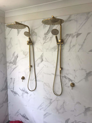 Twin gold showers for a bathroom renovation